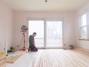 man-kneeling-and-laying-out-new-wood-floor-planks-in-bright-room-in-progress-under-construction_t20_lWQkEk-300x225 man-kneeling-and-laying-out-new-wood-floor-planks-in-bright-room-in-progress-under-construction_t20_lWQkEk