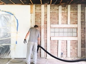 man-vacuums-with-long-shop-vac-hose-in-renovation-room-addition-with-brick-wall_t20_wapo77-300x225 man-vacuums-with-long-shop-vac-hose-in-renovation-room-addition-with-brick-wall_t20_wapo77